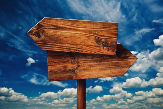 Blank Rustic Opposite Direction Wooden Sign Against Clouds