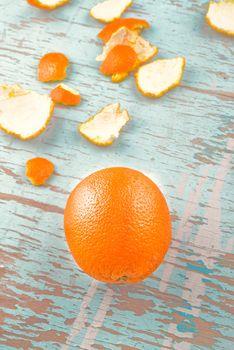 Fresh Orange Fruit and Peel on Rustic Wood Background