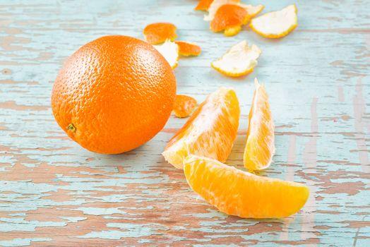 Fresh Sweet Orange Fruit and Peel on Rustic Wood Background