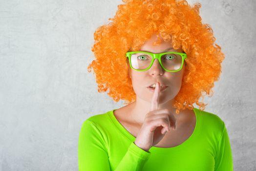 Orange Girl with Finger on Lips