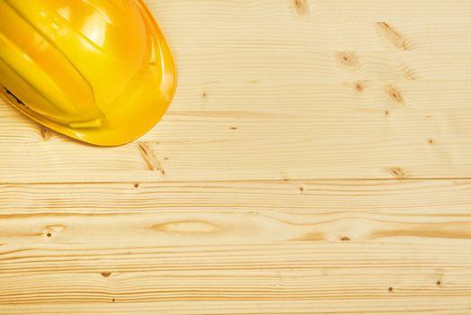 Protective Industrial Helmet on Wooden Background
