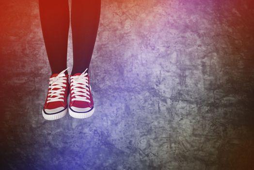 Careless Young Teenage Woman Jumping for Joy