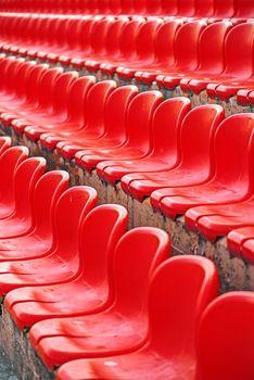 Rows of red empty stadium seats