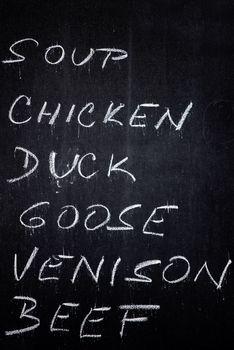 Restaurant Advertising Blackboard with Beverage, Food and Drink Refreshment Drinks List Written in Chalk: Soup, Chicken, Duck, Goose, Venison, Beef