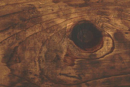 Retro toned rustic wood knot on oak plank