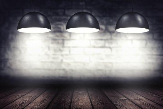Room with three spotlight lamps