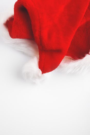 Folded Santa Claus hat on white table