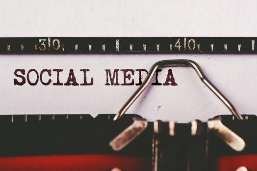 Social media text on old typewriter