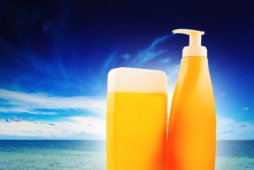 Suntan Lotion Bottles on Seaside Beach