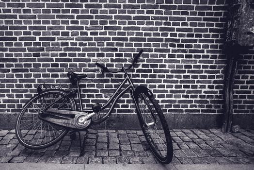 Unique classic vintage hipster bicycle leaning against the stree