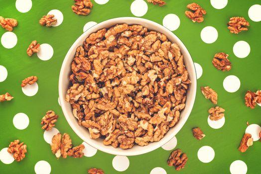 Walnut Kernels in Bowl on Polka Dotted Background