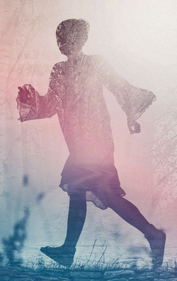 Woman Running to Freedom Through Countryside Field, Silhouette of Female Person, Double Exposure, Vintage Retro Tone Effect.
