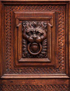 Lion Head as Wood Carving in Old Door