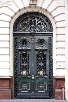 green door and  head of lion