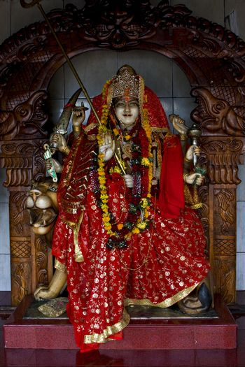 precious stone   wood statue of a Hinduism  women