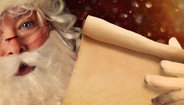 Closeup of Santa Claus holding a Santa List scroll