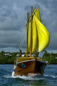 cloudy  pirate boat  and coastline in mauritius