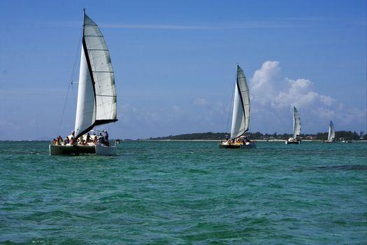 navigable  froth cloudy  catamaran and coastline