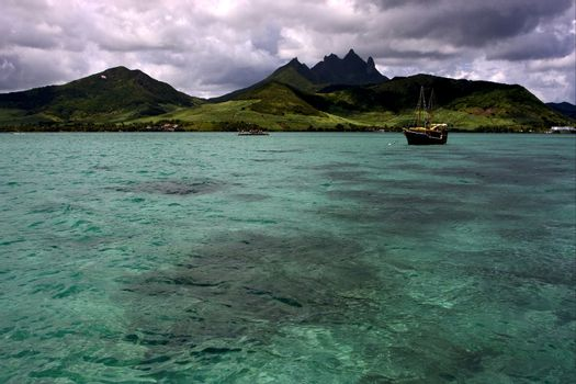 tropical lagoon hill navigable     boat  and coastline in Deer I