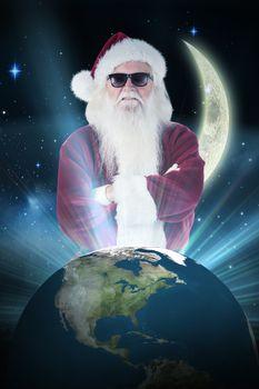 Composite image of santa claus wears black sunglasses