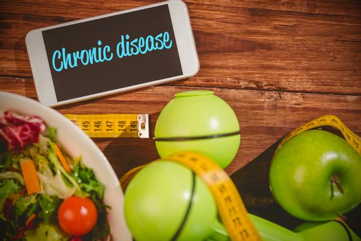 Chronic disease against phone on healthy persons desk