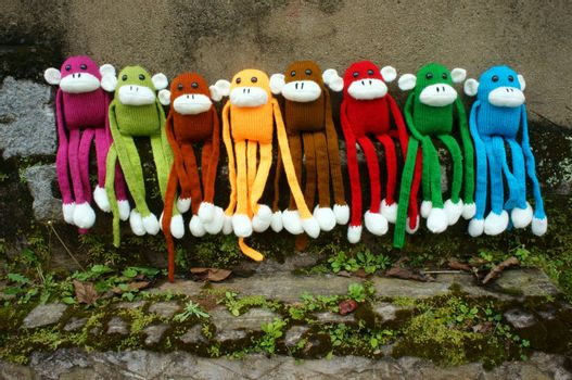 Amazing scene with group of knitted monkey climb tree, 2016 is year of the monkey, monkey symbol in colorful yarn to happy new year