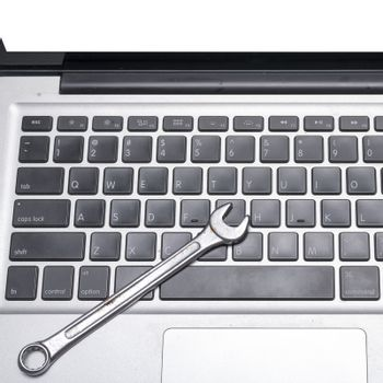 wrench on laptop