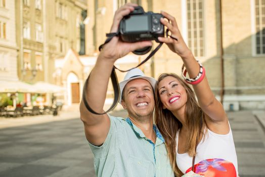 Happy Couple Of Tourists
