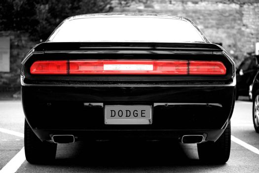 Mainz, Germany - July 17, 2015: The back of a black sports car the car brand Dodge with two exhausts on July 17, 2015 in Mainz.
