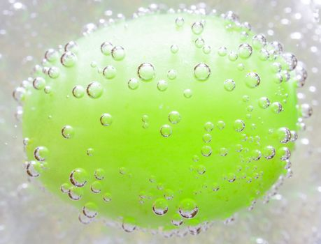 The photo depicts the grapes in the bubbles