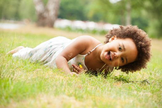 African young girl is having fun outside