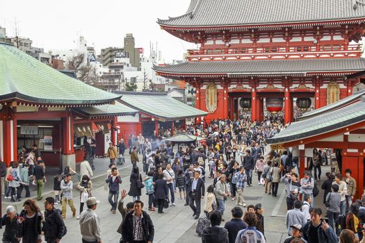 TOKYO, JAPAN - MARCH 31, 2012: Crowd of japanese people walking around the most famous Sensoji buddhist temple in Asakusa,Tokyo.