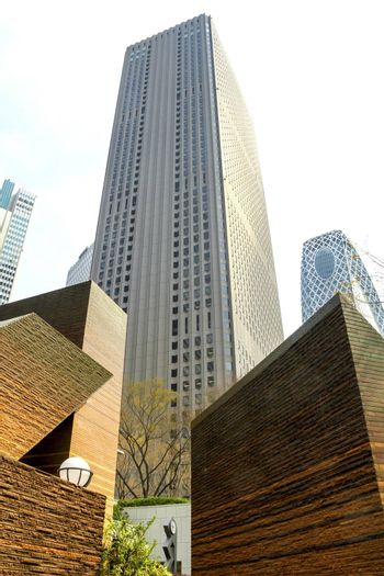 Tall skyscrapers of Shinjuku district in Tokyo, Japan. Vertically oriented low angle view with vintage looking photo filter