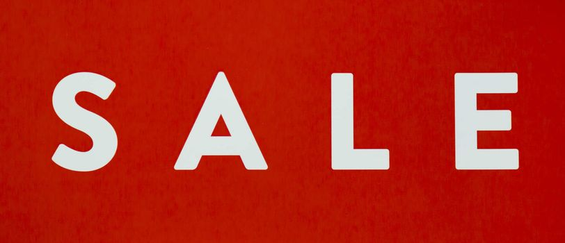 Sale Sign Close Up white and red.