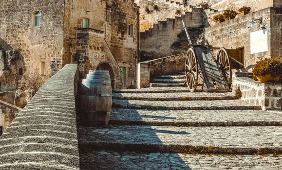 old historical scene with wood wagon and wine barrels typical tool used in Matera in the past, old style