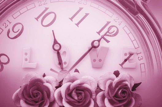 Vintage pink roses flower and love face time background. Time and love concept.