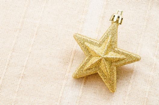 Gold five pointed star christmas decoration.