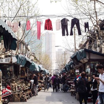 SHANGHAI, CHINA - April 9, 2011 : Amazing view of old town area in Shanghai, There are clothes lines across over the flea market