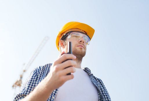 builder in hardhat with radio