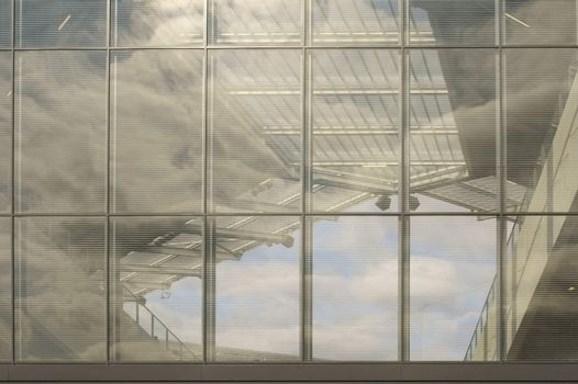 A transparent partition wall on the corner and the roof of a soccer stadium.