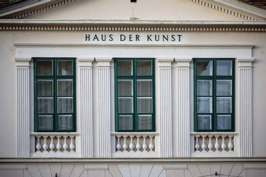 Baden near Vienna, Austria - November 14, 2015: Three windows with columns and an inscription on the facade of the House of Art exhibition on November 14, 2015 in Baden near Vienna.