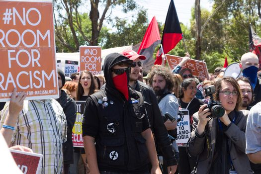 MELTON, VICTORIA/AUSTRALIA - NOVEMBER 2015: Anti Racism protesters violently clashed with reclaim australia groups rallying agsint Mulsim immigration.