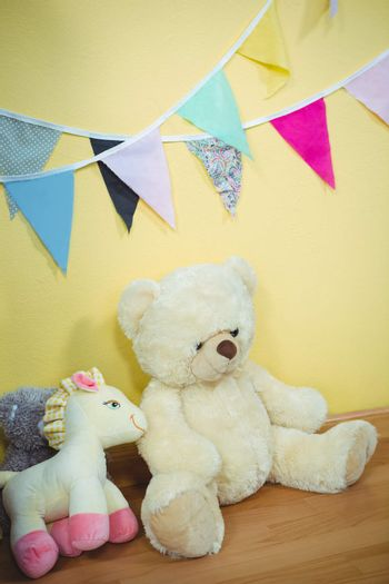 Decorations and fluffy teddies against the wall