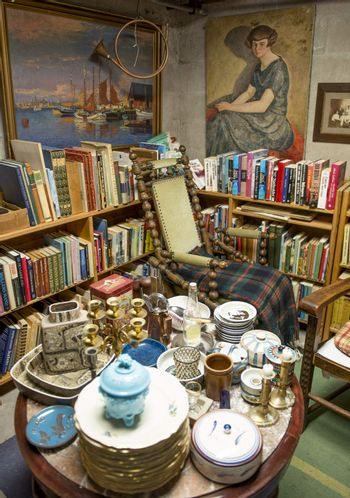 Traditional Antique shop in Denmark. Ceramics, books, pictures and chairs.