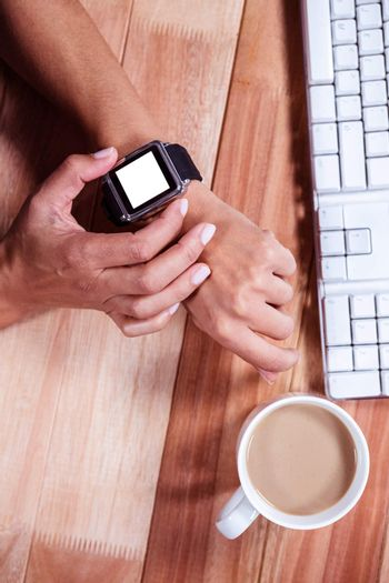 Feminine hands with smartwatch and coffee