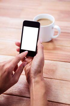 Feminine hand using smartphone