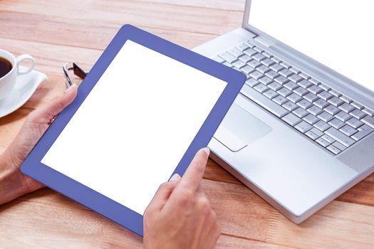 Feminine hands holding tablet
