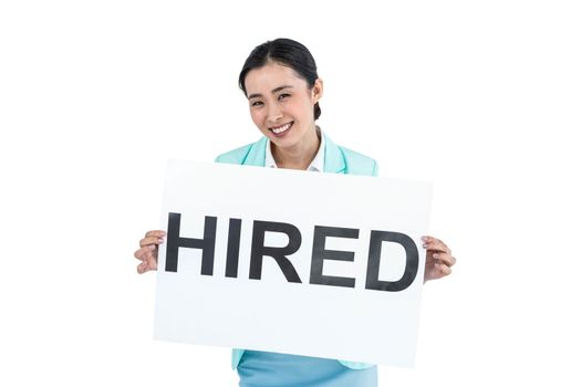 Businesswoman holding a signboard hired