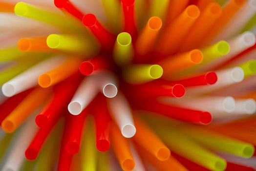 Collection colored drinking straws in blur