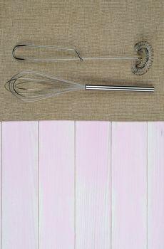 Kitchenware on beige towel
